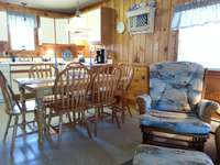 There is a full kitchen table with six chairs for family dining. Also a picnic table and grill are located right outside the cottage.