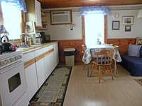 The Cottage has been renovated & all appliances are new. The little Blue couch in the corner is now gone.