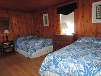 Large bedroom with 2 new full size mattresses.