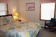Master bedroom has a queen size bed attached to a shared bathroom with the 2nd bedroom