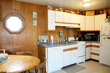 The kitchen is fully appliances with a new dishwasher,  microwave and stove. The kitchen is equipped with pots/pans/dishes and anything you need to make your stay comfortable and relaxing.