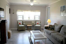 It has a newly remodeled living room with updated air conditioner/heater, a new queen sleeper sofa and tables and a newly installed laminate floor and a 43 inch LCD  t.v.
