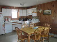 Kitchen includes all the dishes, glassware and pots and pans that you will need to enjoy your stay.Dinning table has seating for six and can accommodate eight.