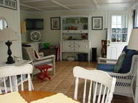 Great enclosed porch with TV