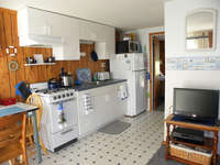 Fully equipped kitchen with new stove for cooking, eating in and entertaining. Living room area with flat screen/cable/DVD and CD player built in. There is a new wall AC unit for those warm and humid summer days.