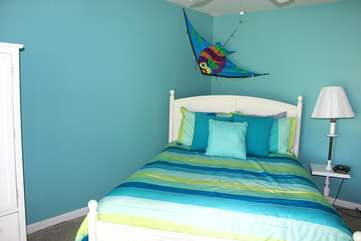 the 4th bedroom is bright and cheery. It has a queen bed.