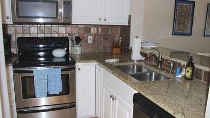 Enjoy a home cooked meal from this remodeled kitchen.