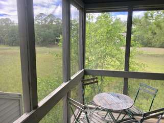 Enjoy the wildlife from the screened in porch.