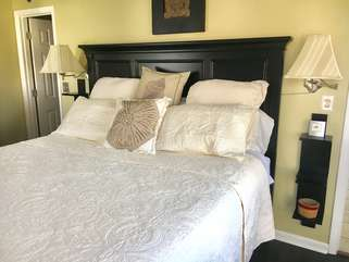 Comfortable king size bed with new bedding.