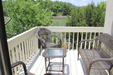 Step to the deck and enjoy reading a book or watching Seabrook's nature.
