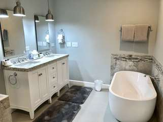 Remodeled master bathroom with a free standing tub, new vanity with granite countertops!