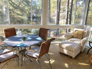 tep out to the sun room to read, watch nature, or dine at the table.