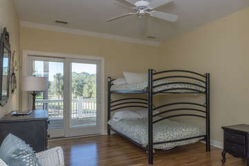 The fourth bedroom has full size bunk beds and access to the outside deck.