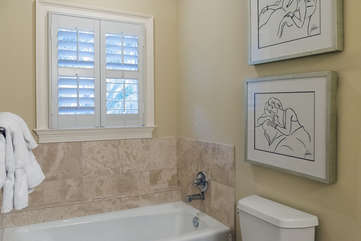 A tub is also in this bathroom.