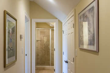 The upstairs center hallway has a full bath at either end and bedrooms off of it.