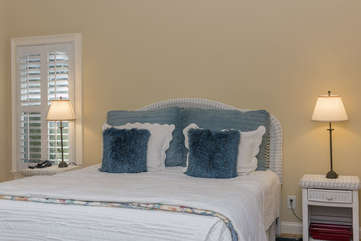 The king size master bed is comfy and inviting.