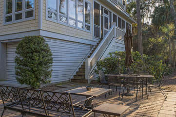 The backyard has ample seating for dining or relaxing and watching for deer.