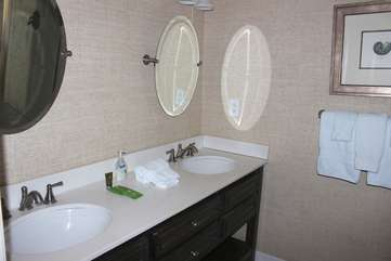 The master bath has a double sink vanity.