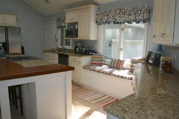 The kitchen has granite/butcher block counters & a window seat.