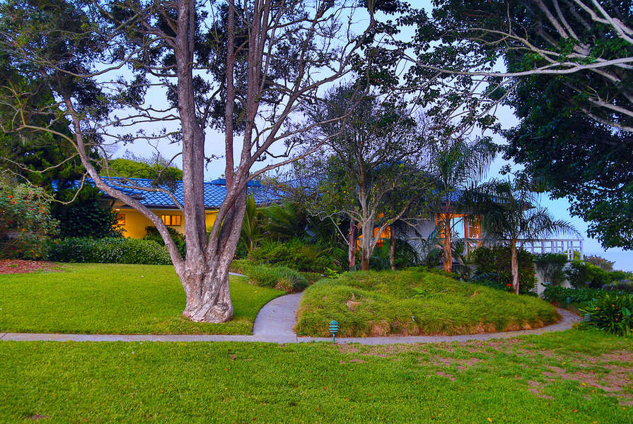 2 acres of tropical grounds surround the home