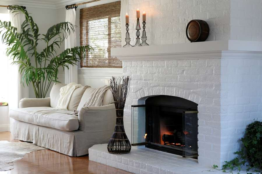 Fireplace between Living Room seating areas