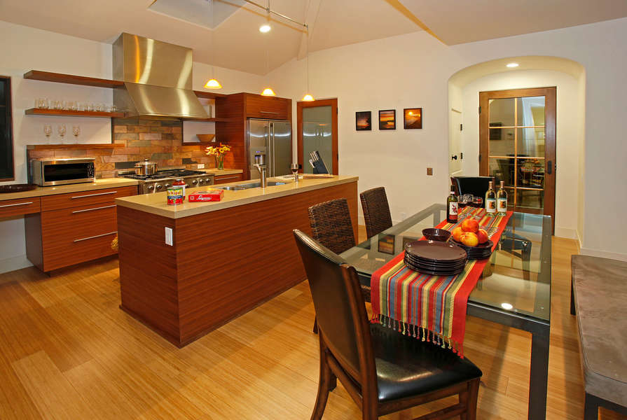 Close to kitchen and dining is a balcony w/barbeque