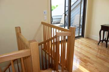 Head up the spiral stairway to the 3rd bedroom and upper sun deck.