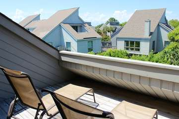 The deck has two chaise perfect for sunning or watching the stars at night.