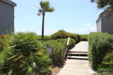 The private beach boardwalk is a short walk from this villa.