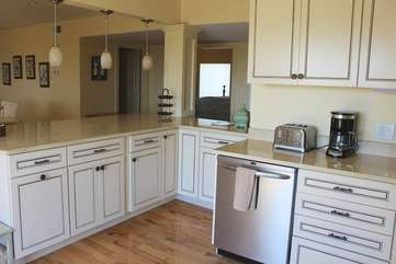 Highlights include custom cabinets, stainless appliances & access to the deck.