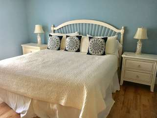 The 1st floor master bedroom has a king bed and en suite bath