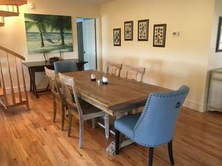 The open space has gleaming hardwood floors and a lovely decor.