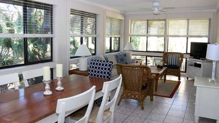 The cottage has a great sunroom that has great golf views.
