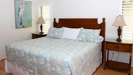 The master bedroom has a king bed and Tommy Bahama furniture.