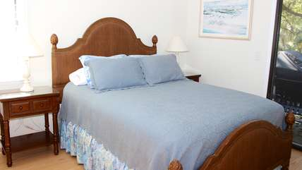Off a small hall are two additional bedrooms and a full bath.