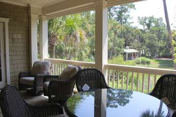 The porch overlooks Palmetto Lake. Down the path is the neighborhood pool.