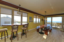 Dining Area with Custom Surfboard Tables