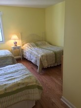 Bedroom with 2 twin beds  and 1 full size bed