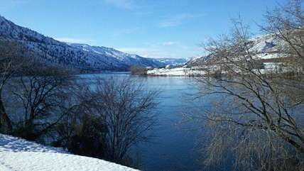 Views of the water and beautiful snowy hills