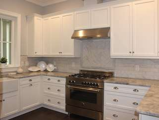 Custom cabinetry & tile, and a 5 burner gas range are highlights.