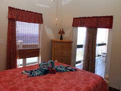 Queen Guest Suite features door to Balcony