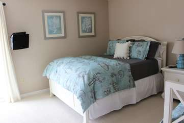 The bedroom has a queen bed and a day bed (twin) so it comfortably sleeps 3 guests.