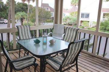 Enjoy appetizers or dinner on the screened porch. There is a table for 6.