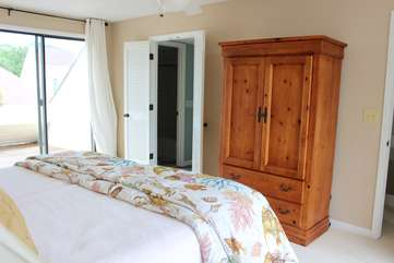 The armoire not only offers storage for clothing, but there is a large HDTV too.