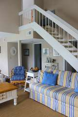 The open stairway leads to the master bedroom suite.