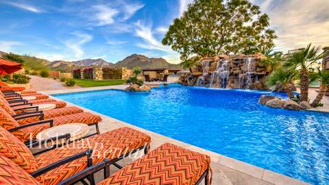 Pool view with lawn chairs