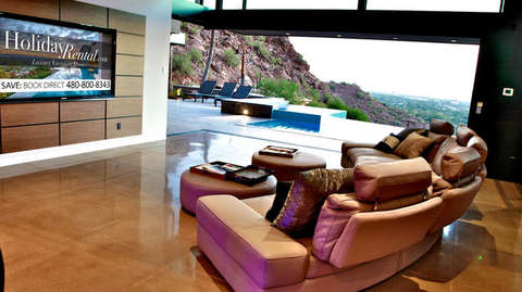 Living Room with pool and city views