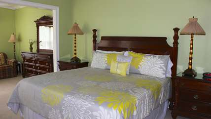 The upstairs master bedroom has a king bed and sitting room.