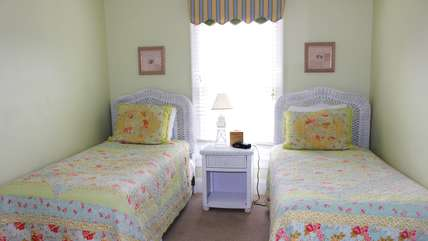 The 2nd bedroom in this home has two twin beds.