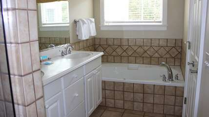 The master bath and a double sink and jacuzzi tub.